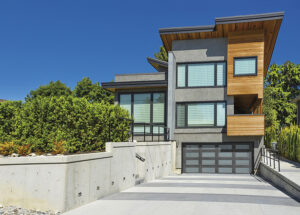 A contemporary home with complementary garage door style.