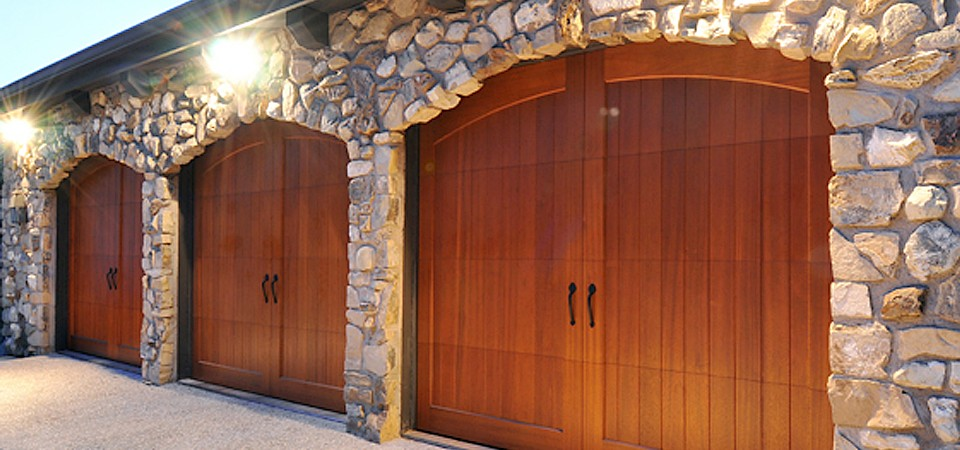 Garage door materials 101 wood vs wood composite for Composite wood garage doors