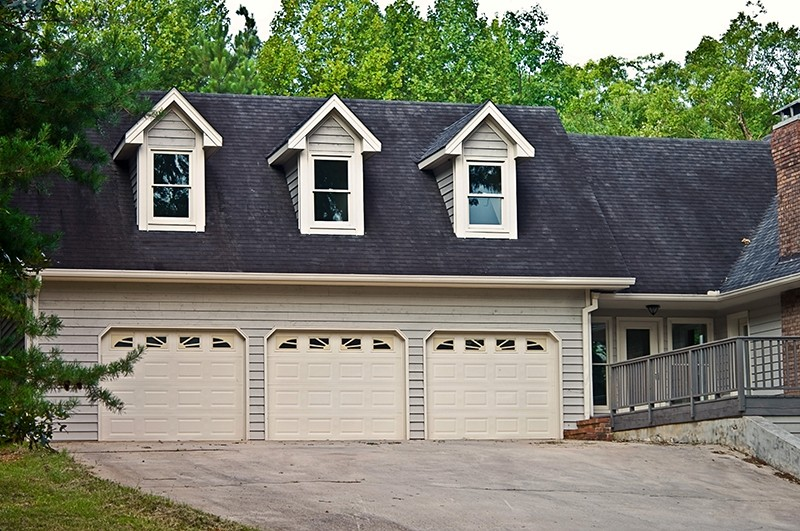 garage with three doors