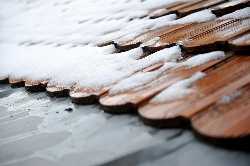 Snow melting on a Denver roof