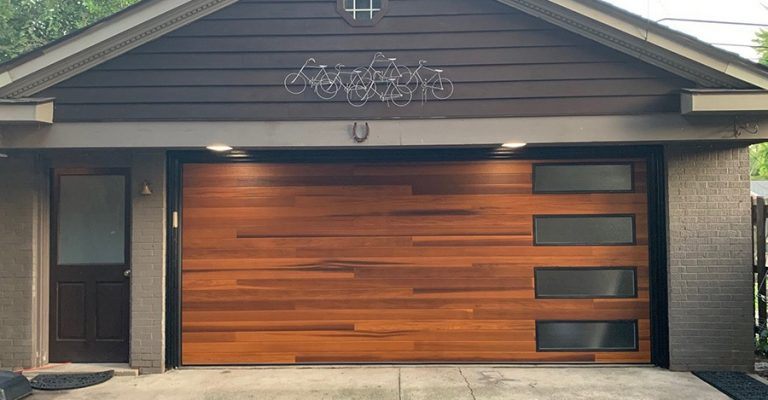 A steel garage door made to look like interlaced wood.