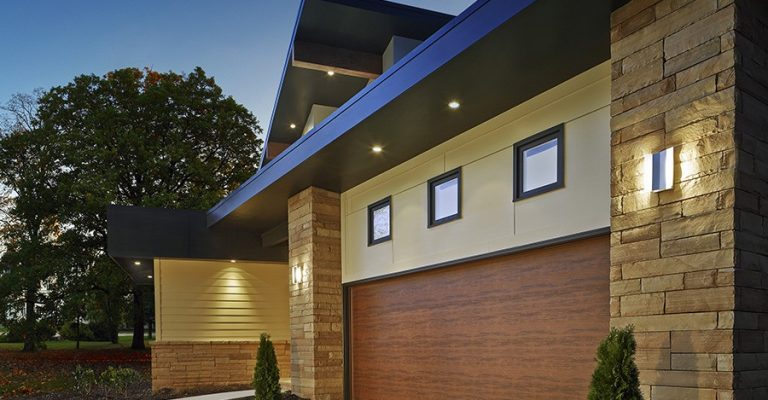 A custom garage door that aligns with color scheme and layout of the home.